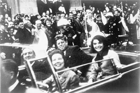 John and Jacqueline Kennedy in the Dallas motorcade on Nov. 22, 1963, shortly before his assassination. Photo by Victor Hugo King, placed in the public domain