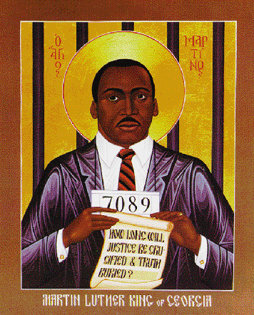 """How Long WILL Justice Be Crucified and Truth Buried?"" This icon by Robert Lentz depicts Martin Luther King, Jr. as a martyr for justice. The prison number around his neck and the jail bars represent his many arrests for civil disobedience. The Greek inscription by his head reads, ""Holy Martin."" Icon by Robert Lentz © Bridge ""Martin Luther King of Georgia"" Building Images"