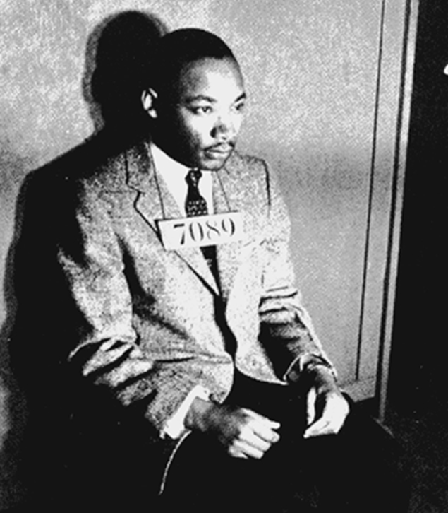 Martin Luther King, Jr., prisoner #7089, has his mug shot taken by police after he was arrested during the Montgomery bus boycott. Photo by Marion S. Trikosko, U.S. News & World Report Magazine