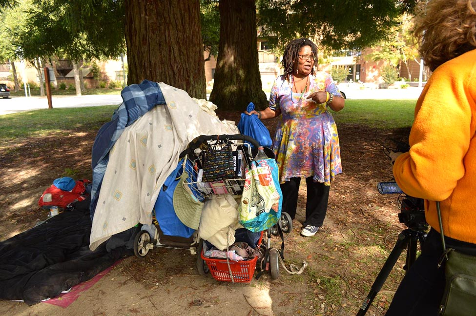 """A woman named Butterfly packs her belongings in San Lorenzo Park in Santa Cruz. This photo was taken by Natalia Banaszczyk as part of a Santa Cruz project called """"Not the Other: Oral Histories of People Experiencing Homelessness."""""""