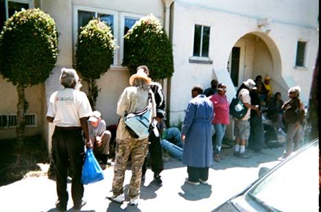 """""""Coming Together to Eat."""" People line up to eat at a church in Berkeley. """"Churches have been helping poor people for a long time. They provide nutritional food which enables people to live and have hope.""""  Vernon Andrews photo"""