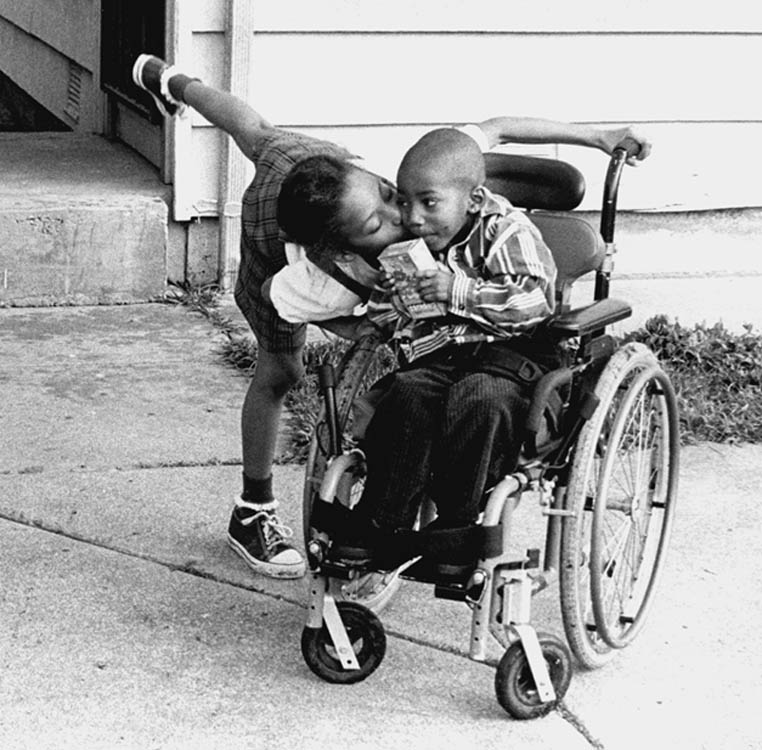 """""""Love in motion."""" This image shows how love and devotion create an inclusive sense of family. Lydia Gans has done a documentary book on disabled people. Photo by Lydia Gans"""