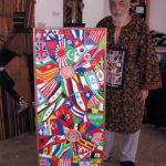 "Arnold White with his painting, ""Peace Not War."" Intertwined flowers are patterned like national flags. The painting shows ""the way it should be, nations flowering together for peace and not war."" Lydia Gans photo"