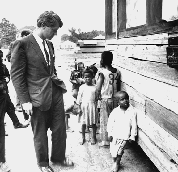 Senator Robert Kennedy visited the Mississippi Delta in 1967 where he found children starving in windowless shacks, and saw the urgent need to combat poverty.