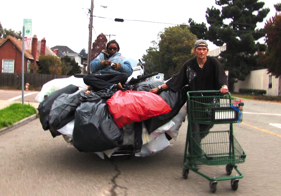 This hardworking couple pick up a huge amount of recycled material on their travels through the East Bay.