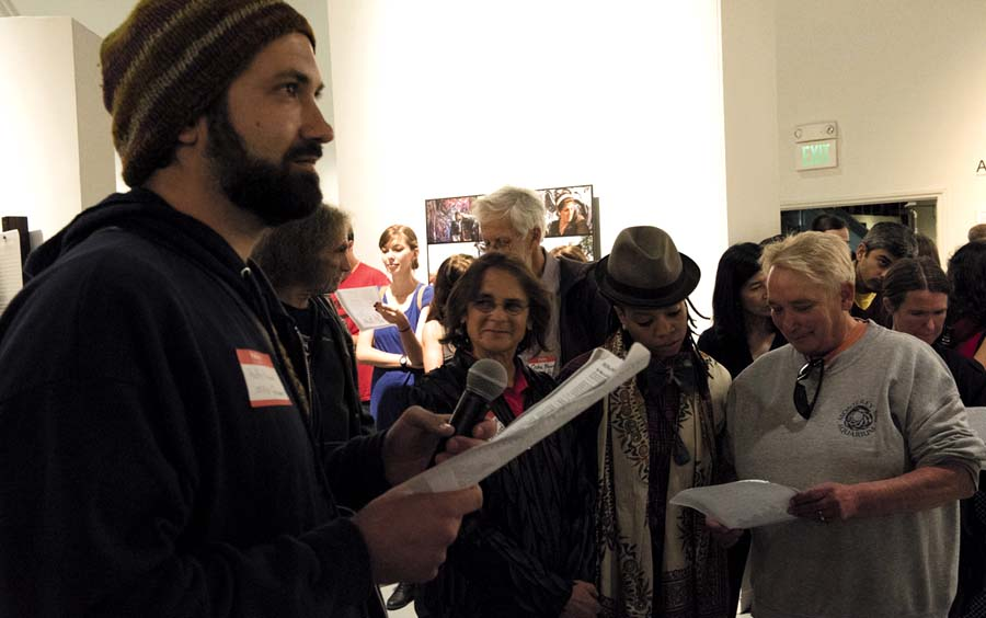 Andy Kreamer, a former resident of the Albany Bulb,, asked people at the exhibition to call out the names of Bulb residents who had been lost.. Robin Lasser photo
