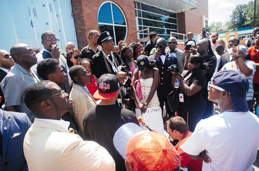 Protesters gathered at the Ferguson Police Department after Michael Brown was killed on August 9, 2014. In December 2014, the Berkeley police violently attacked demonstrators who were protesting this police killing. Photo credit: Jamelle Bouie