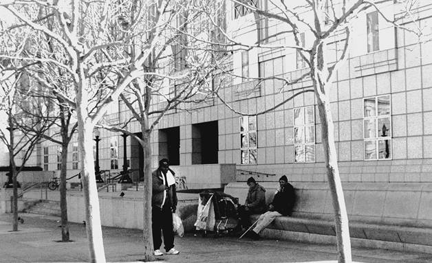 Homeless people sit outside the San Francisco Public Library. Lydia Gans photo