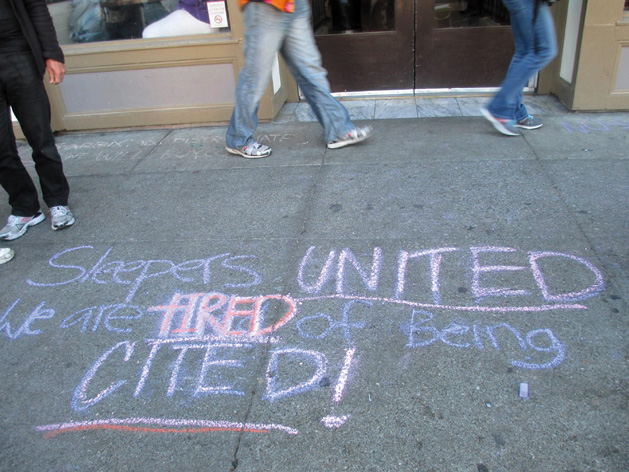 """The finished message: """"Sleepers United. We are tired of being cited!"""" Dozens of chalked messages have been written on Berkeley sidewalks. Sarah Menefee photo"""