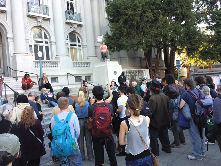 Protesters held a rally on March 17 before speaking against anti-homeless laws at the City Council meeting. Sarah Menefee photo