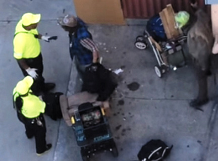 DBA ambassadors confront a homeless man just before they began beating him. This is a screen shot of Bryan Hamilton's video that has been posted to YouTube.