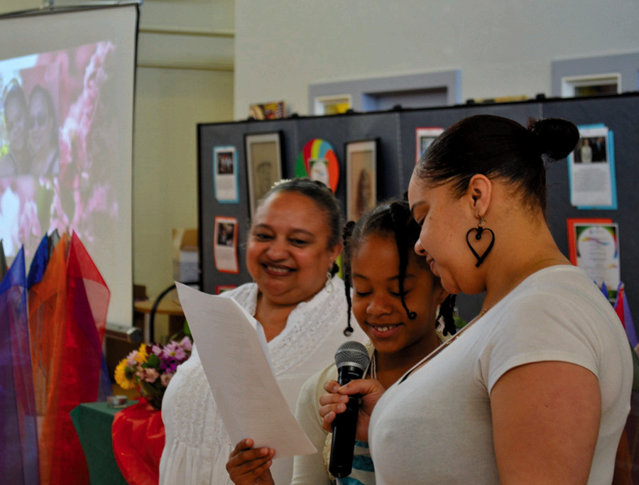 "Janny Castillo (left) reads ""Three Generations"" with her daughter and granddaughter at St. Mary's Center in Oakland."