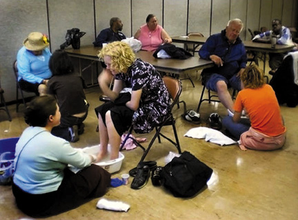 Volunteers at the Suitcase Clinic offer footwashing and many kinds of free health care to homeless and low-income persons.