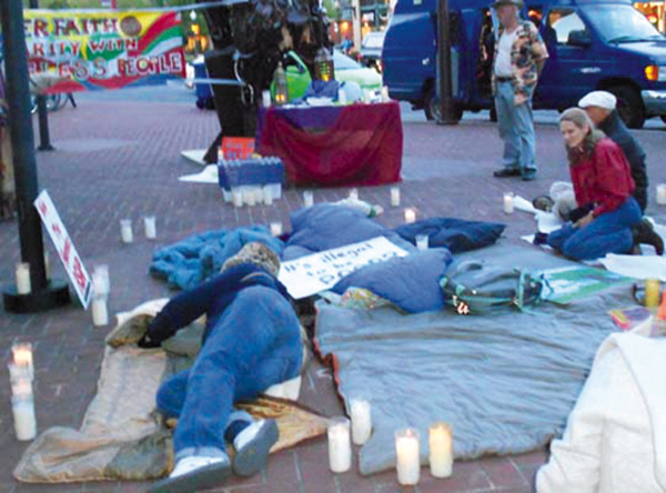 Vigilers begin bedding down for the night at the BART Plaza in protest of Berkeley anti-homeless laws. Lydia Gans photo