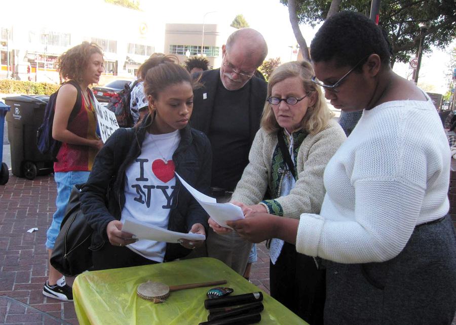Carena Ridgeway, Rev. Kurt Kuhwald, Sally Hindman and Rayven Wilson organize the rally's speakers. Alex Madonik photo