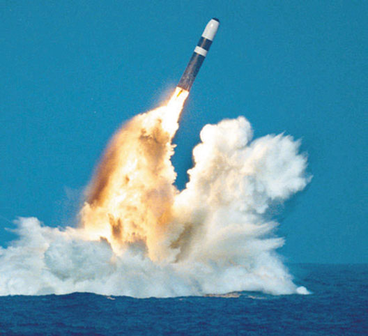 A missile is fired from a Trident submarine. Lockheed missile designer Robert Aldridge determined that their accuracy and explosive power give the Trident missiles a first-strike capability.