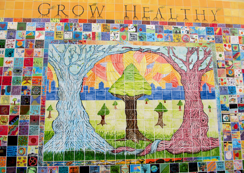 """""""GROW HEALTHY."""" Young artists working with Youth Spirit Artworks created this tile mural to educate the public about the severe health disparity between low-income and wealthy residents in Berkeley."""