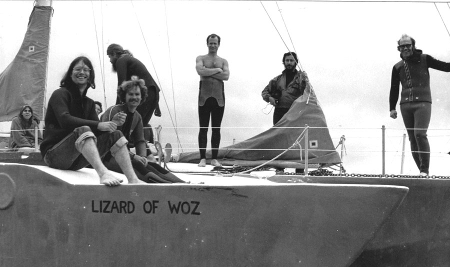 Peace activists on board the Lizard of Woz sailboat prepare to blockade the Trident submarine in Puget Sound. Darla Rucker sits at the rear in the far left. Terry Messman and Bruce Turner sit on the deck in the left foreground. Jim Douglass stands at far right.