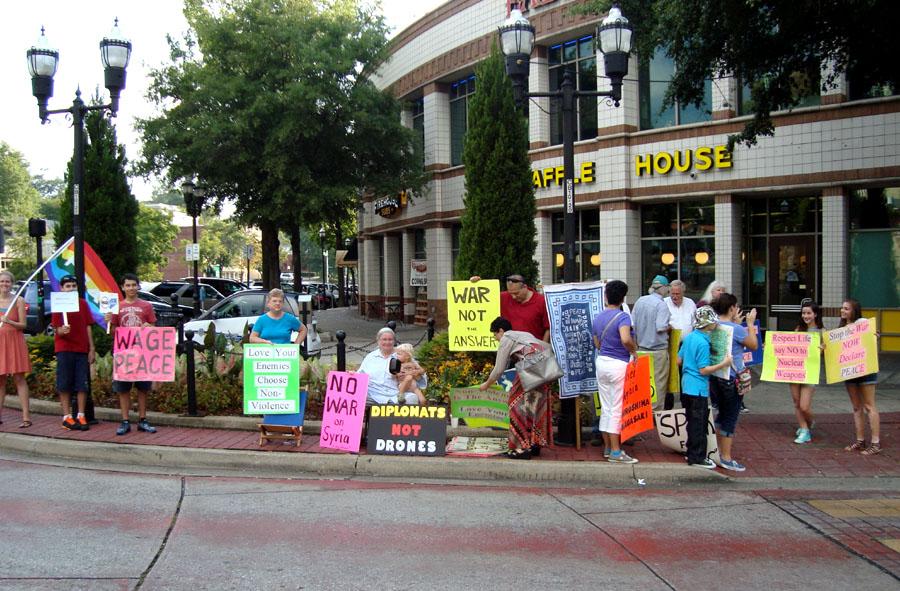 Shelley and Jim Douglass help organize vigils for peace every week in downtown Birmingham, Alabama.