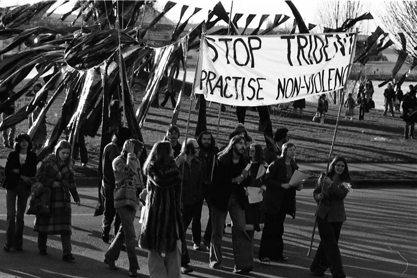 """Anti-nuclear demonstrators parade the """"Trident Monster"""" through the streets of downtown Vancouver, British Columbia."""