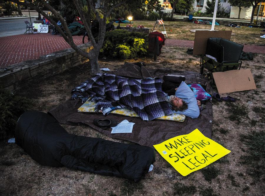 """Make Sleeping Legal.""  People even display protest signs in their sleep in Santa Cruz. Photo by Alex Darocy, Indybay.org."