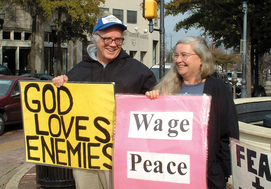 Jim and Shelley Douglass demonstrate against the Iraq War at their weekly peace vigil in Birmingham, Alabama.