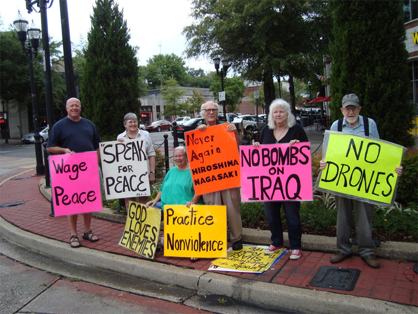Jim and Shelley Douglass hold a protest in Birmingham, Alabama, of U.S. drones and bombing raids on Iraq.