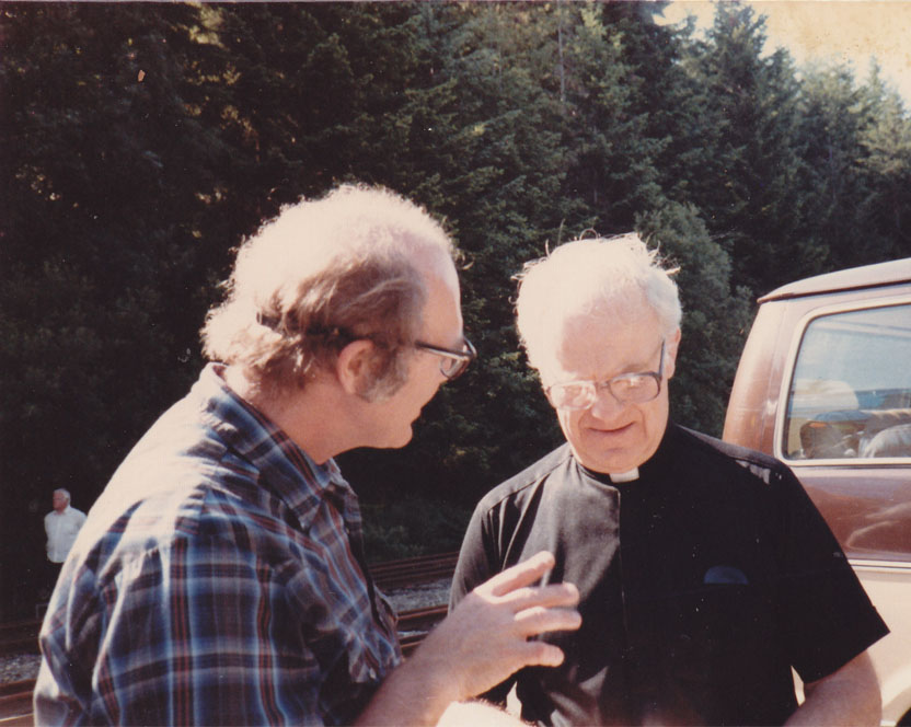Jim Douglass (at left) talks with Archbishop Raymond Hunthausen at a Peace Pentecost action at the Trident naval base. Photo by Tom Douglass