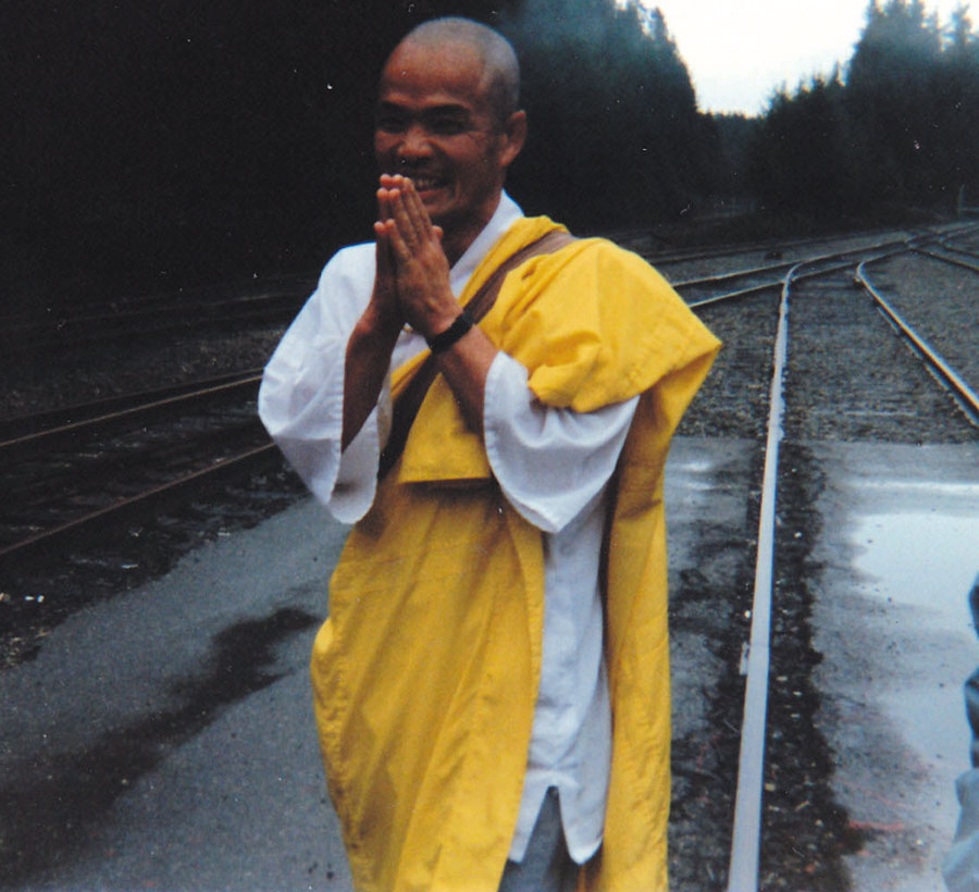 A Buddhist monk, Utsumi Shonin, prays for peace on the railroad tracks that transport Trident nuclear missiles into the Bangor Naval Base.