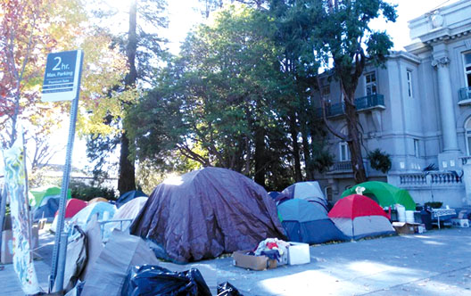 """The residents of the homeless occupation at old City Hall in Berkeley named their cluster of tents, """"Liberty City."""""""
