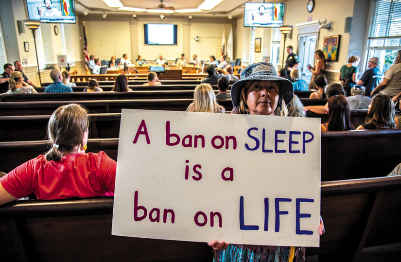 """""""A ban on sleep is a ban on life."""" Freedom Sleepers take their message of protest inside the chambers of the Santa Cruz City Council. Alex Darocy photo"""