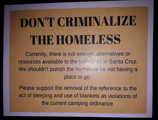 """Don't Criminalize the Homeless."" A sign posted by homeless advocates in Santa Cruz."