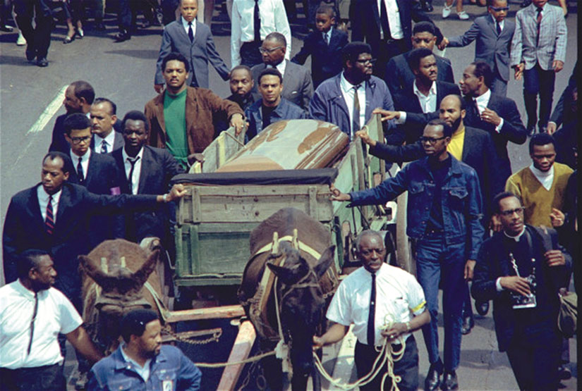 A mule-drawn wagon bears the casket of Rev. Martin Luther King, Jr. on his funeral procession in Atlanta, on April 9, 1968, five days after his assassination in Memphis.
