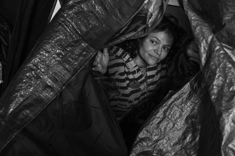 Michelle Lot, a homeless woman, lives in the occupation at Berkeley Post Office. Photo by David Bacon