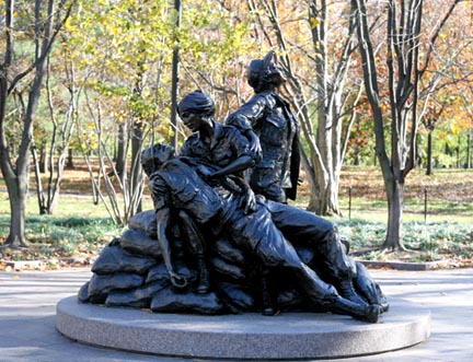 The Vietnam Women's Memorial in Washington, D.C., is dedicated to the women who served in the Vietnam War, most of whom were nurses. It depicts three uniformed women with a wounded soldier. It was designed by Glenna Goodacre.