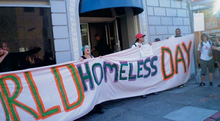 In honor of the first World Homeless Day, activists and homeless people rallied at San Francisco City Hall, and then staged a takeover of the vacant Leslie Hotel. Photo by Carol Harvey
