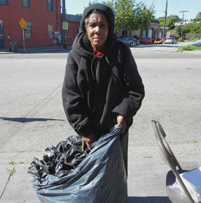 Darlene Bailey, a longtime Oakland recycler, is taking home bags for packaging the material she will put in the bins at the recycling center. Lydia Gans photo