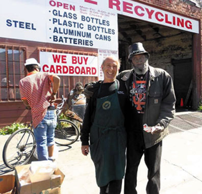 Darrell Hopkins, retiring from years of recycling, and Joe Liesner, a Food Not Bombs member who brings food to the recyclers, have become good friends. Lydia Gans photo