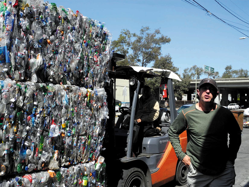 Lance Finkel runs Lakeside Recycling, a clean and spotless business operating in Oakland since 1936. Well-organized bales of crushed recyclables wait for transport.