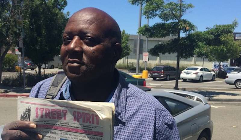 Alando Marcell Williams displays the June issue of Street Spirit. Photo and story by KALW