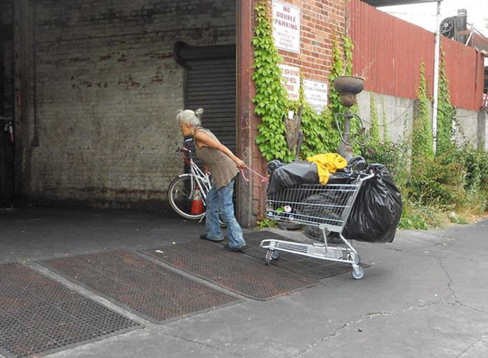 A woman pulls a cart full of recyclables to Alliance on its last day. Lydia Gans photo