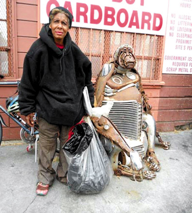 Darlene Bailey, a longtime recycler, delivers her last load to Alliance Recyling, standing near the gorilla creatively sculpted out of car parts. Lydia Gans photo