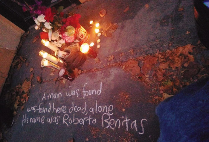 """Flowers and candles were placed as a memorial on the sidewalk where a day laborer died in Berkeley. Written in chalk are the words: """"A man was found here dead, alone. His name was Roberto Benitez."""" Daniel McMullan photo"""