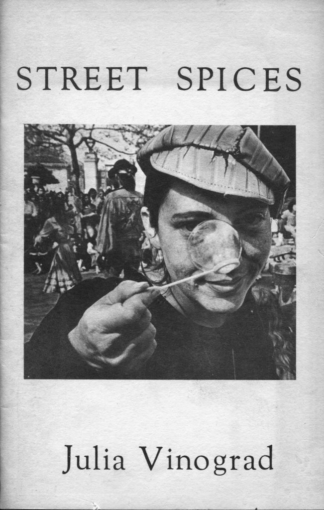 """A portrait of a young Julia holding a bubble wand up to her nose on one of the first pages of """"Street Spices,"""" one of her poetry books."""