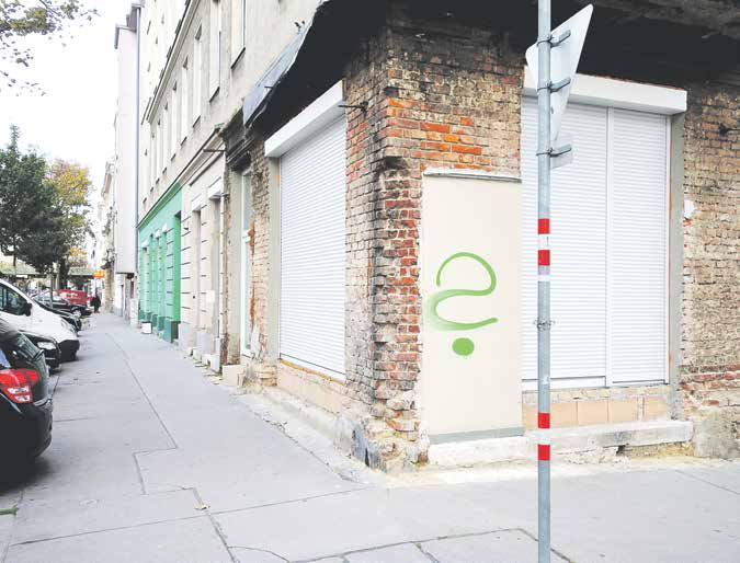 Brunner Strasse—a street in Vienna where sex workers often work. Someone stray painted a green question mark onto the wall.