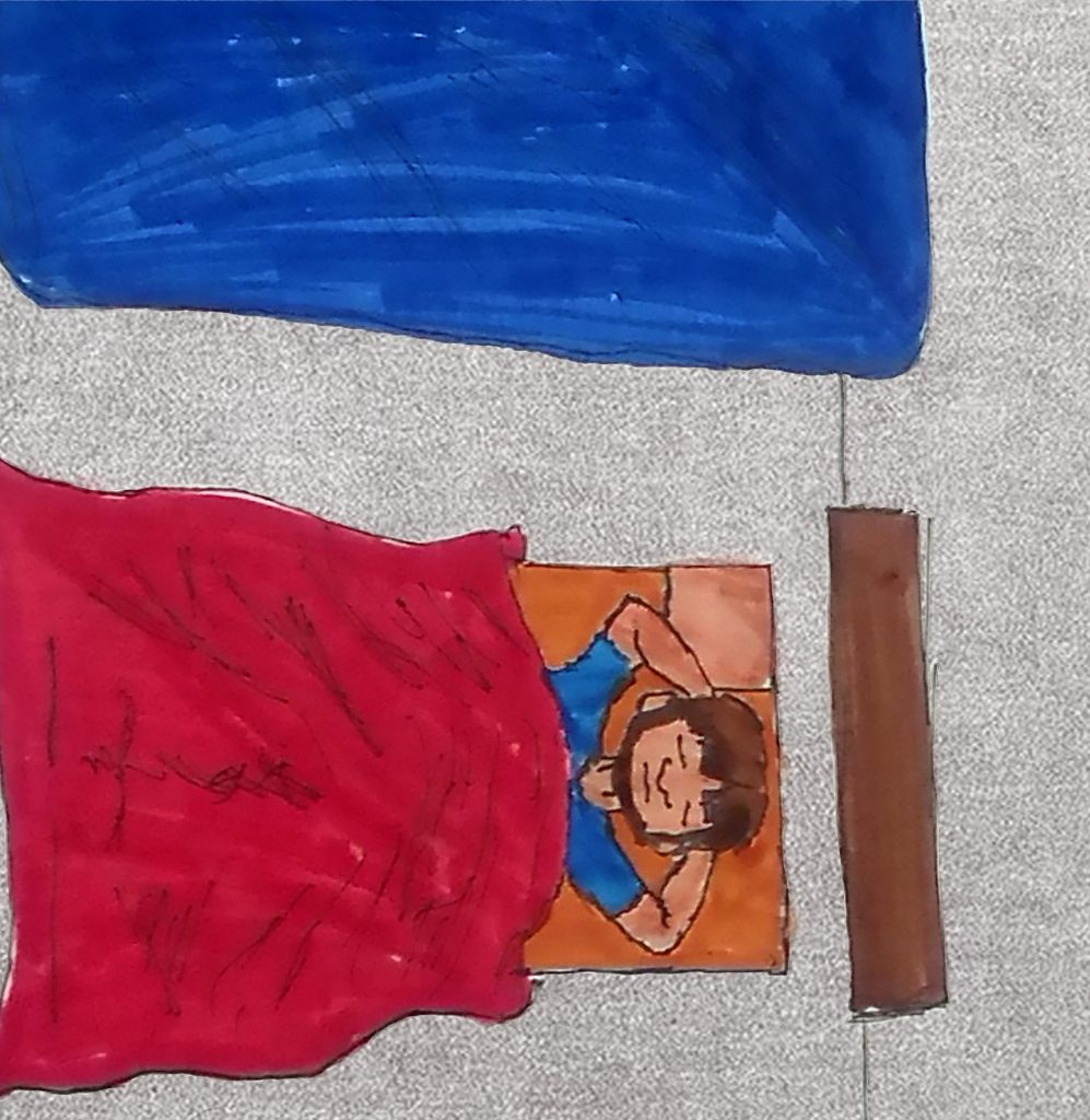 A drawing of Andy sleeping on the floor next to his bed in a sleeping bag.