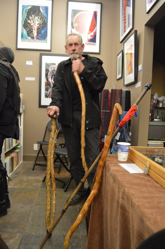 Kent Doull with his hand-carved walking sticks.