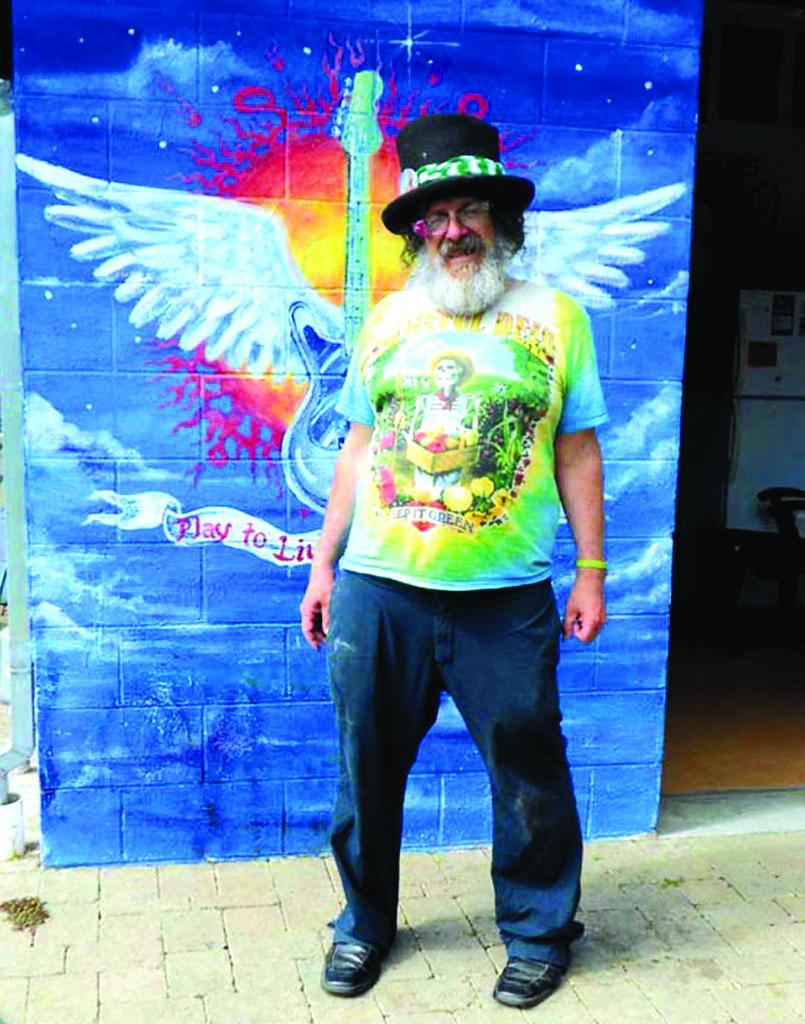 Michael Diehl poses in front of a mural in 2014.