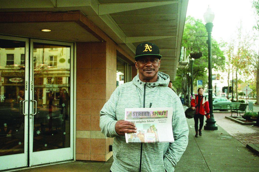Photo of Harold Jackson holding Street Spirit.