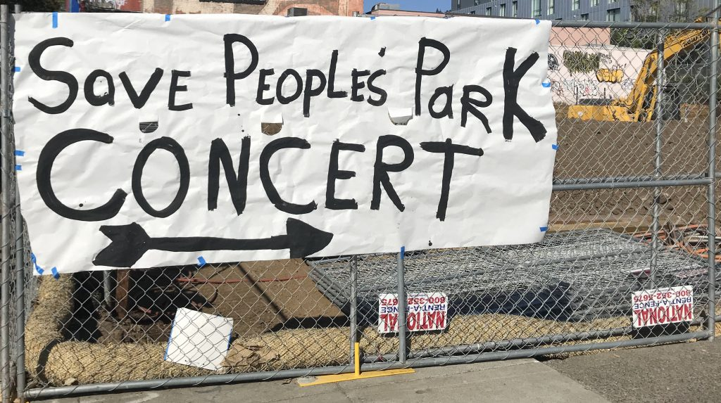 """A sign advertising the concert reads """"save people's park concert"""""""